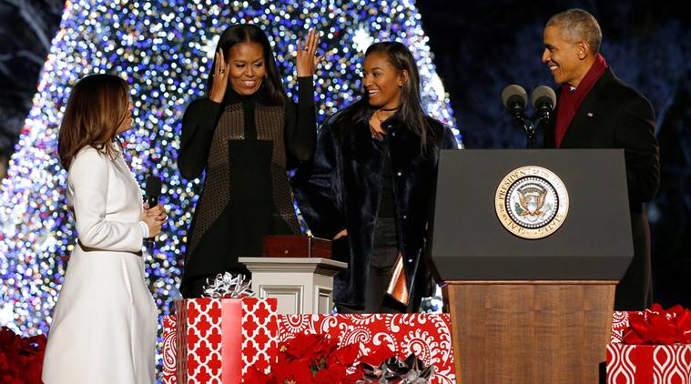 Obama, joined by the first lady, their daughter and Longoria, reacts after pressing a button to light the National Christmas Tree in Washington